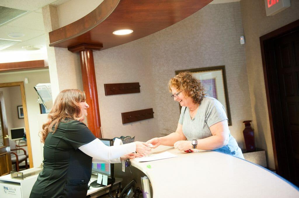 Schneider family dental team working with patient